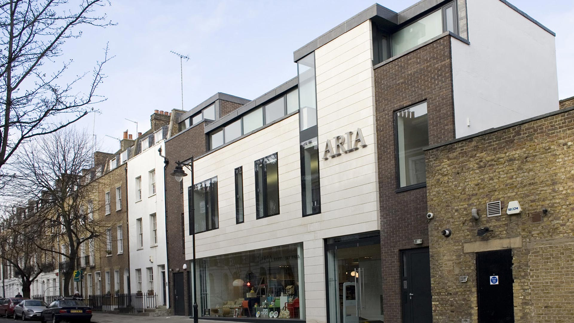 Islington retail qubed for Modern retail building design